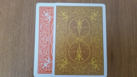 The border of the card is thinner than your standard bicycle back. Compared against Bicycle Orange.