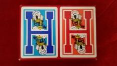 Back: 2 cards glued onto the back.